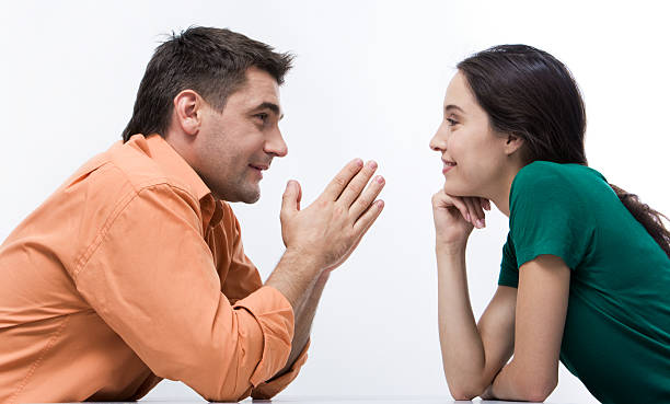 Conversation Happy couple having conversation face to face and looking at each other    Note to inspector: the image is pre-Sept 1 2009 face to face stock pictures, royalty-free photos & images