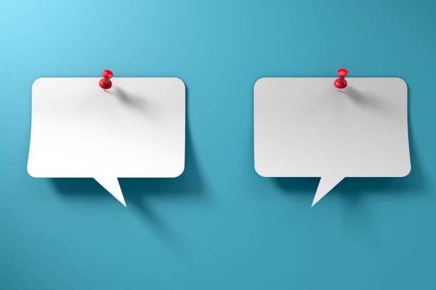 Conversation Speech bubbles on Blue Paper Background stock photo