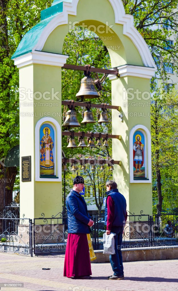 Conversation with the priest. stock photo