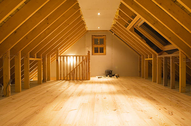 Converted attic space Nearly finished loft conversion with beams still exposed, and new wooden floor.  attic stock pictures, royalty-free photos & images