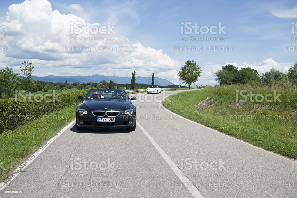 BMW 630 Convertible and Porsche Boxster on a country road stock photo