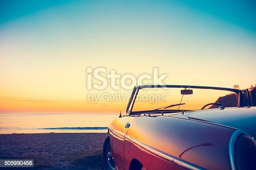istock Convertible at the beach at sunset or sunrise. 505990456