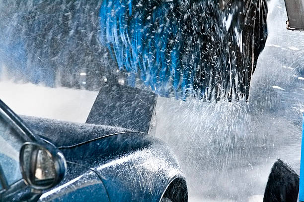 Convertible going through Car Wash close up during carwash with fokus on the front tire hood river valley stock pictures, royalty-free photos & images
