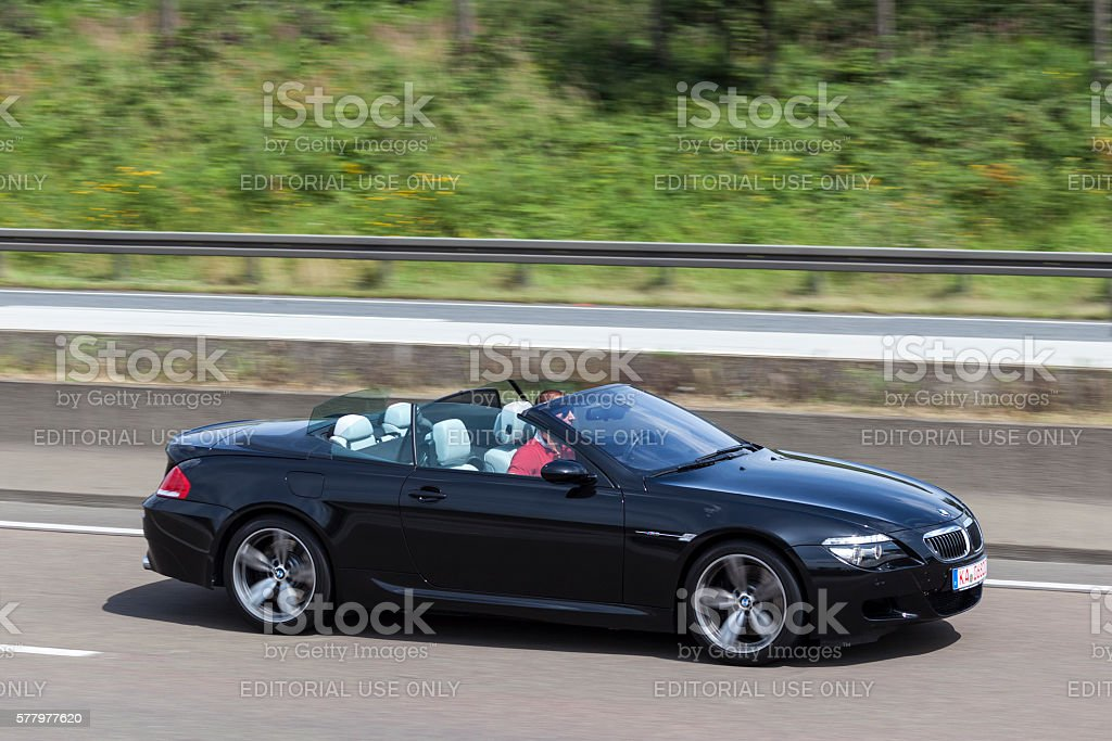 BMW M6 Convertible on the road Frankfurt, Germany - July 12, 2016: Black BMW M6 Convertible on the highway in Germany Autobahn Stock Photo