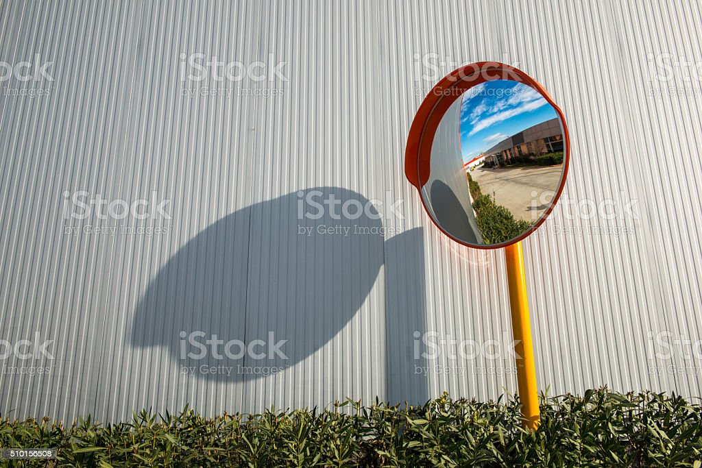 Convex mirror on textured wall stock photo