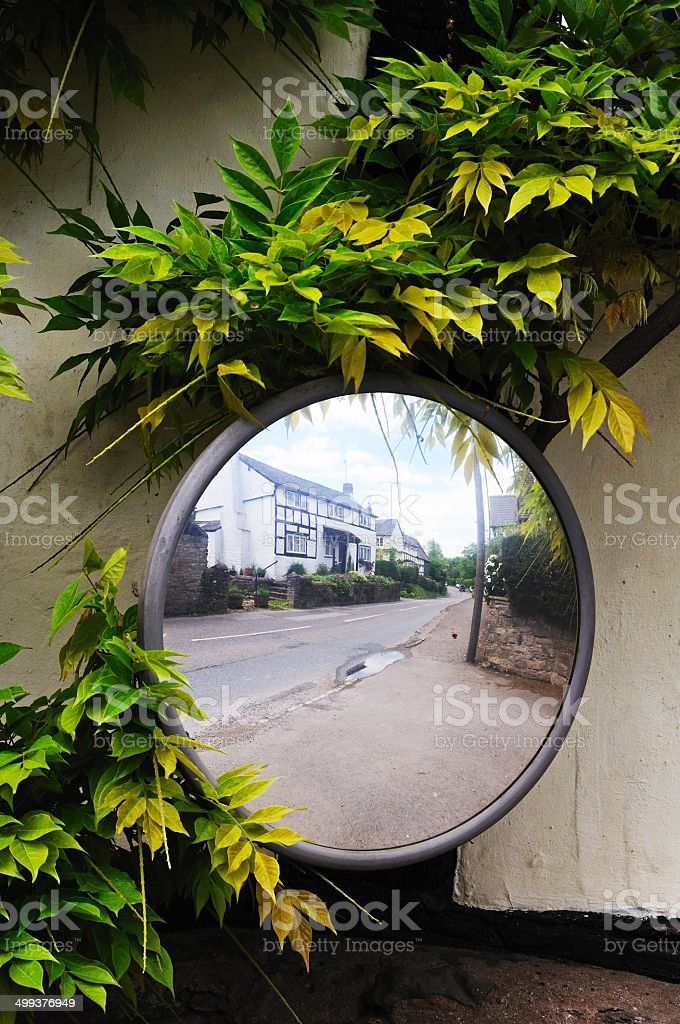 Convex road safety mirror, Pembridge. stock photo