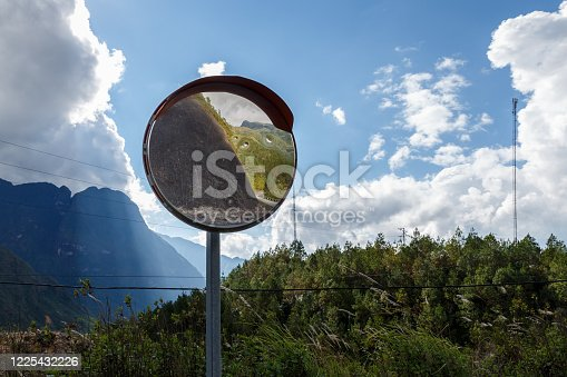 convex spherical road mirror. Road mirror for road safety in the mountains.