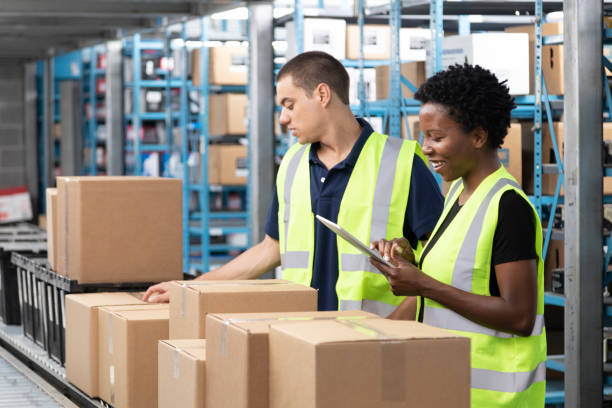 Conveyor Belt and Warehouse Workers stock photo