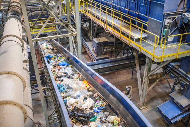 Conveyor Belt for Recyclables in Waste Processing Facility stock photo