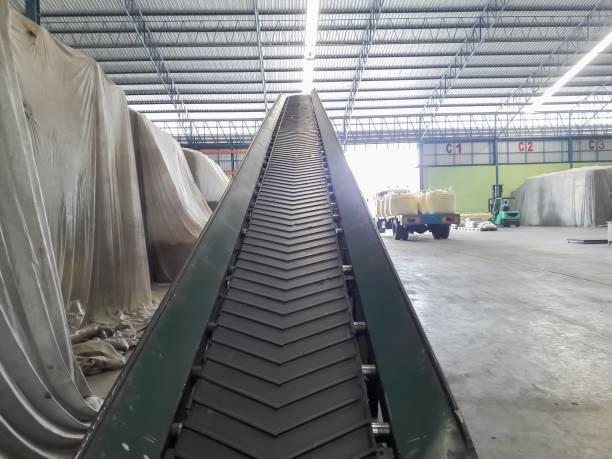 Conveyor belt for rice sacks in the building stock photo