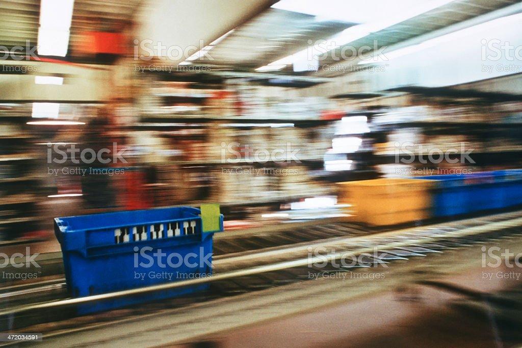 Conveyor belt for storage boxes stock photo