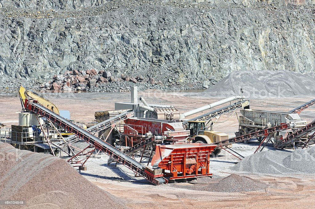 Conveyor Belt in a quarry open mine pit stock photo