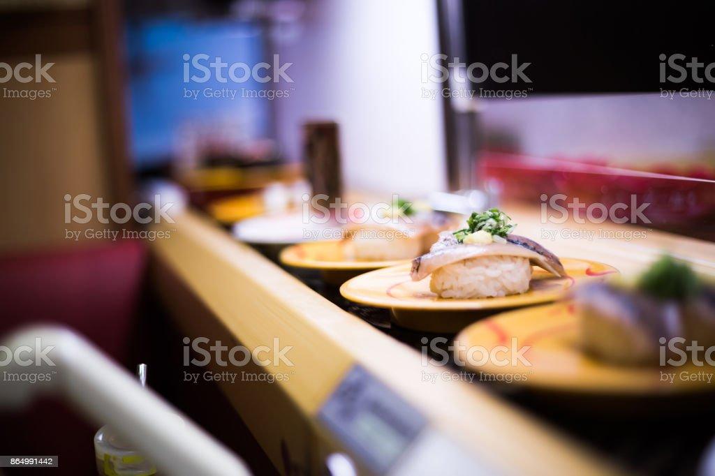 Conveyor belt sushi stock photo