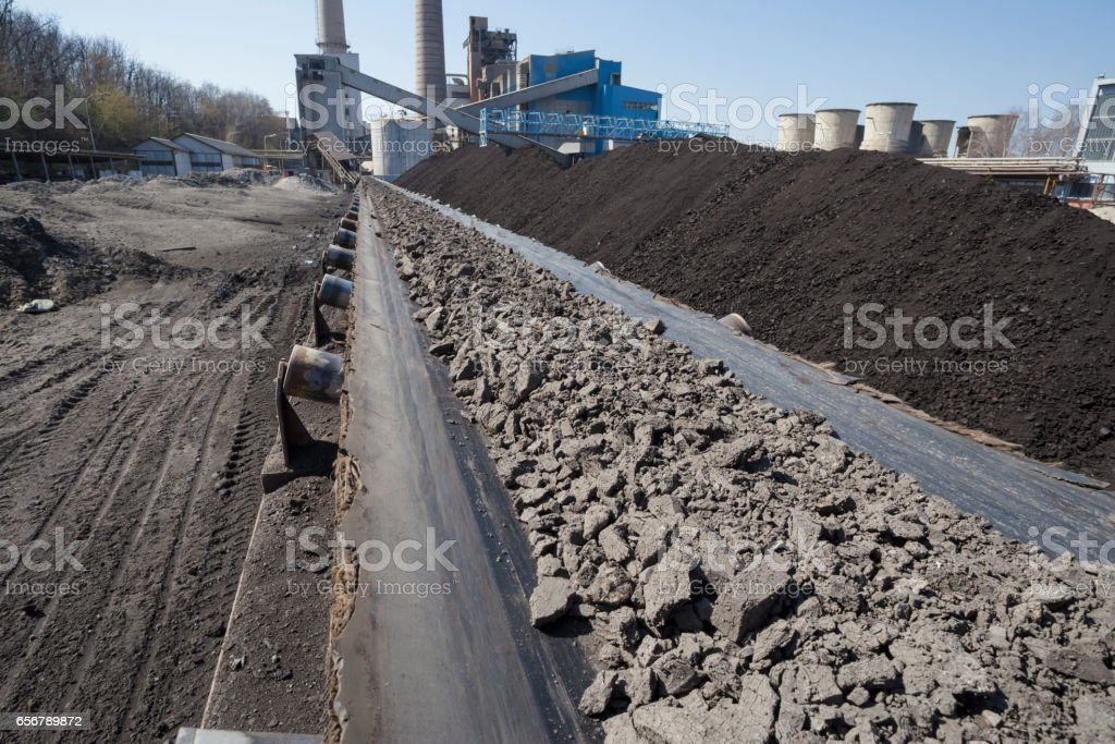 Conveyor belt transporting coal to a thermal power plant stock photo