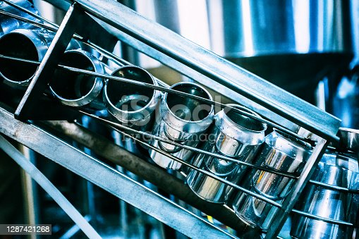 istock Conveyor belt with beer cans.Production of beer beverage, beverage bottling in banks. Tightening the lids on the aluminum beer can 1287421268