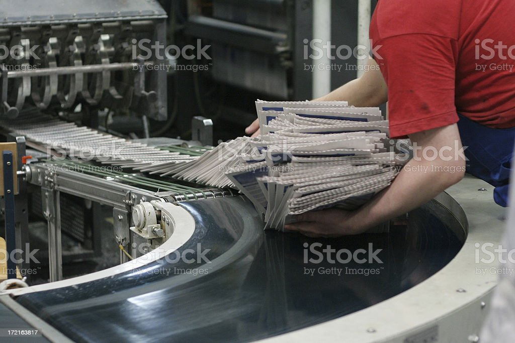 conveyor belt with newspapers royalty-free stock photo