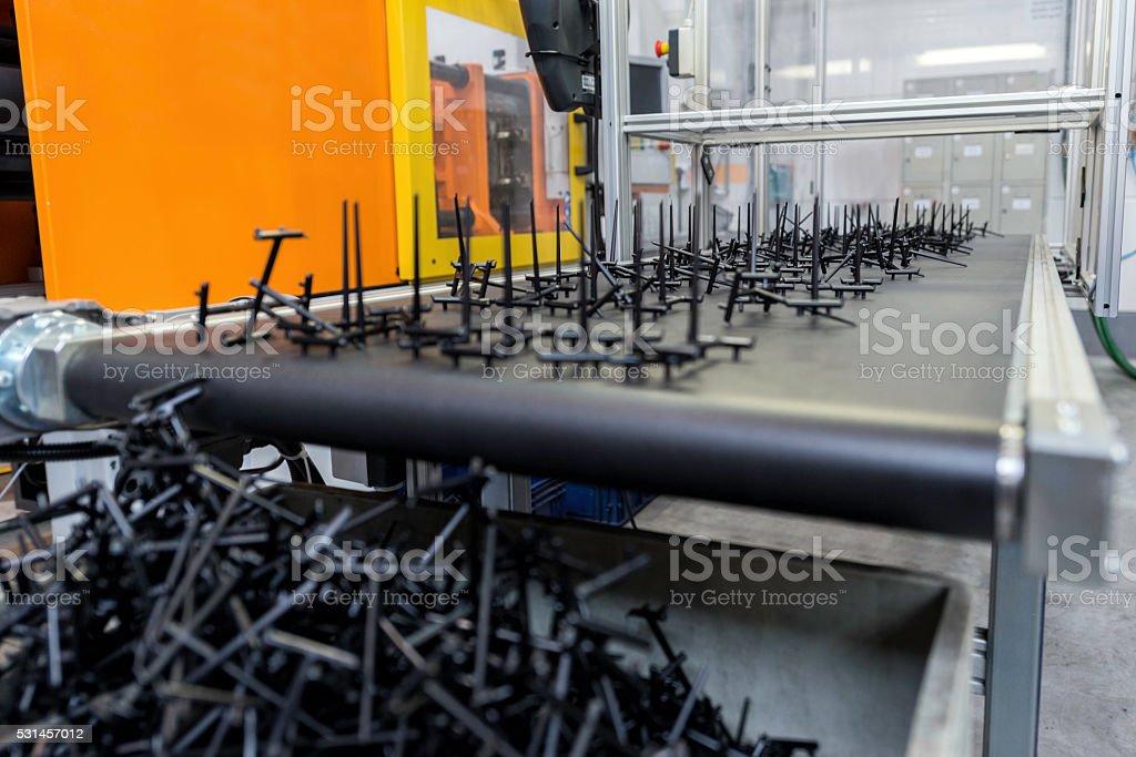 Conveyor belt with plastic black parts stock photo