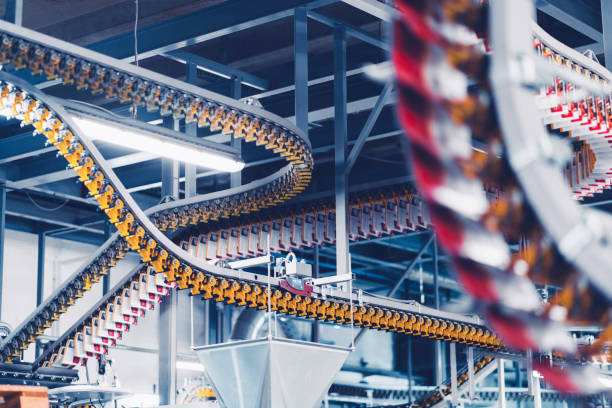 Conveyor belts transporting freshly printed magazines stock photo