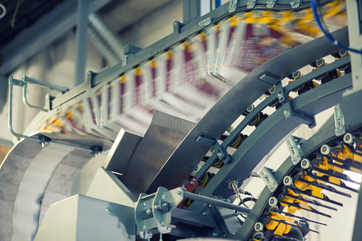 conveyor belts with newspapers in printing press picture id1127947556?k=6&m=1127947556&s=170667a&w=0&h=WGSeORuUFCVm8zQyTacNt 8a6BRc3rAB0M4F9wc9WgE=