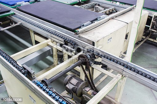 istock Conveyor chain drive shaft production line of the factory 1015433336