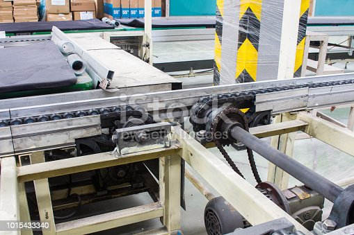 istock Conveyor chain drive shaft production line of the factory 1015433340