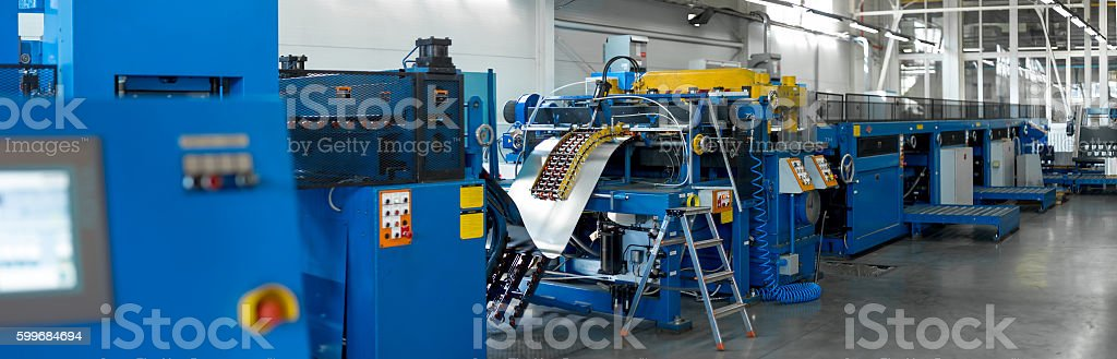 conveyor for cutting sheet metal, shop for metal drawing stock photo