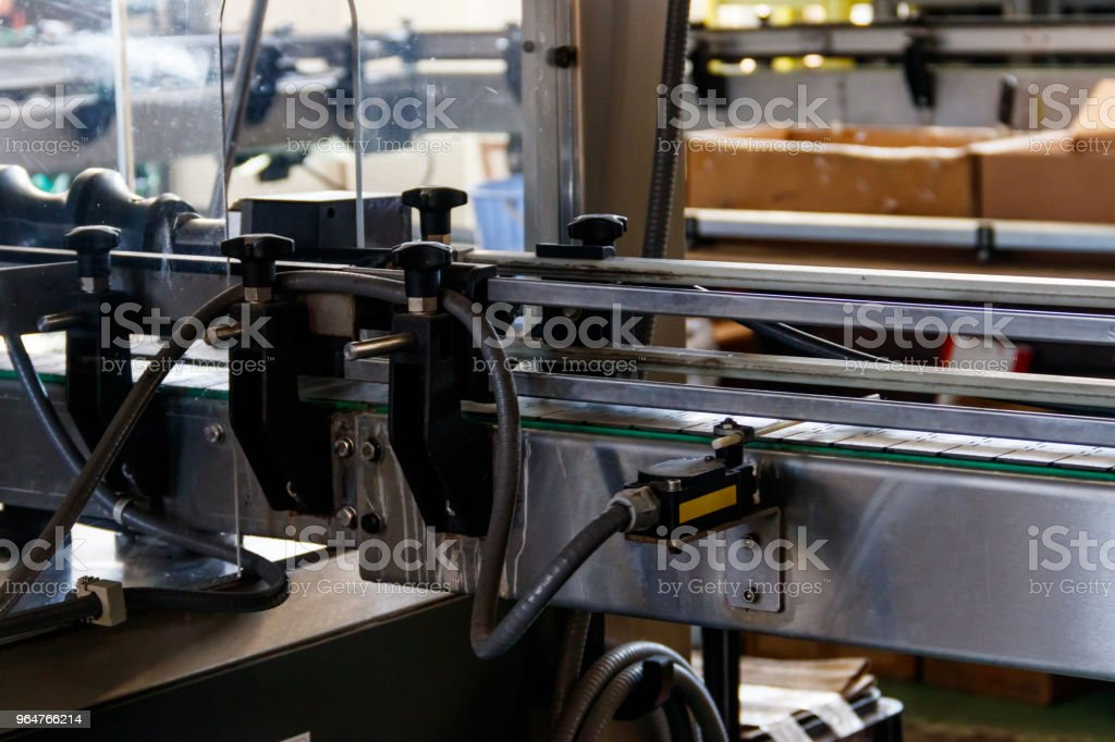 Conveyor for transportation of glass bottles. Production and bottling of alcoholic beverages royalty-free stock photo