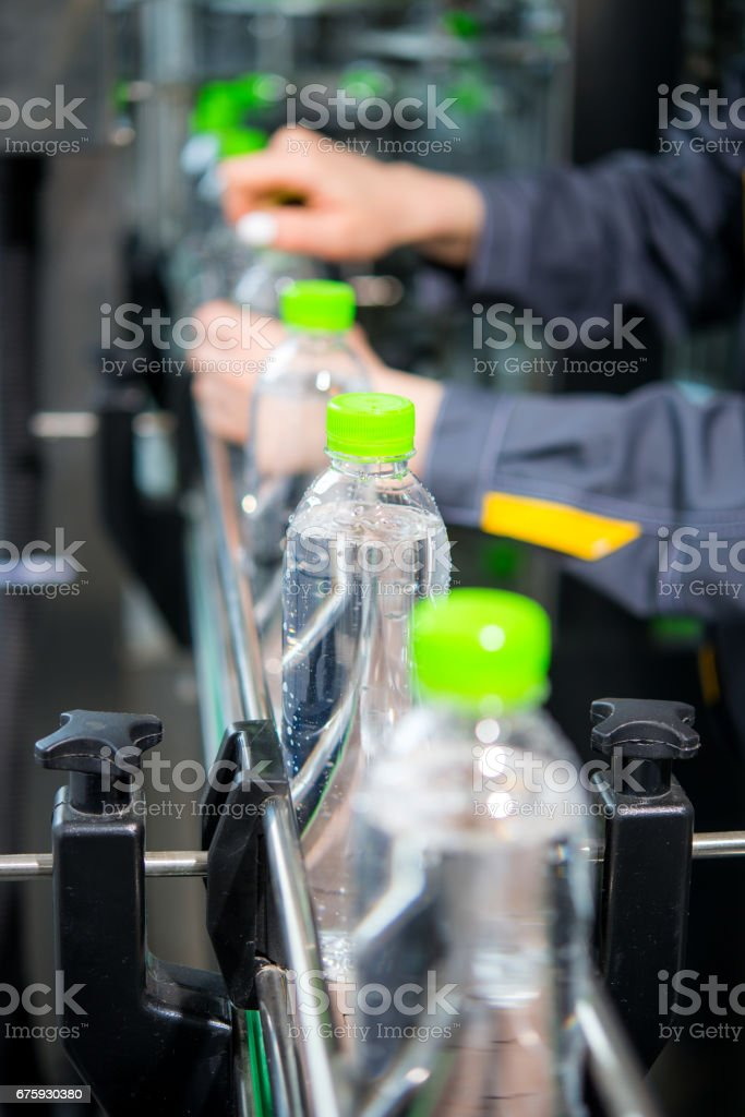 Conveyor with water bottles stock photo