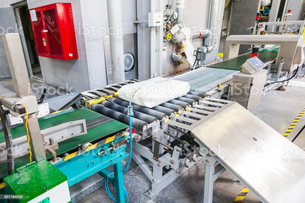 Conveyor with white briquettes chemical industry stock photo