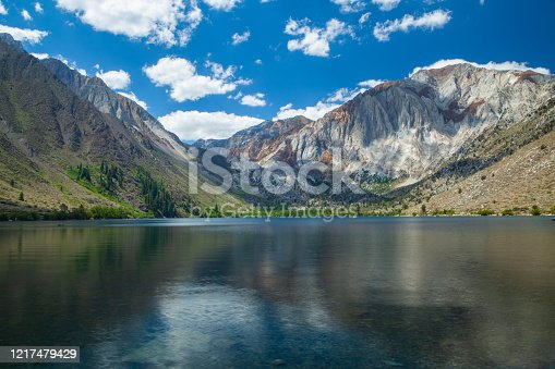 Reflections on the water at Convict Lake in Mono Country California in the Sierra Nevada Mountains, near Mammoth Mountain. Laurel Mountain in the background.Convict Lake was originally carved out by glaciers.