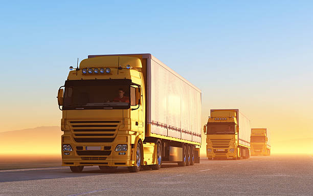 Convoy of yellow trucks on the road convoy of trucks caravan photos stock pictures, royalty-free photos & images