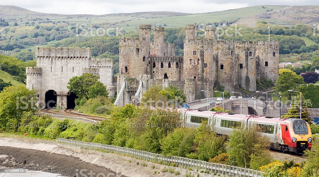 Conwy Castle a Virgin Train traveling through the welsh countryside stock photo