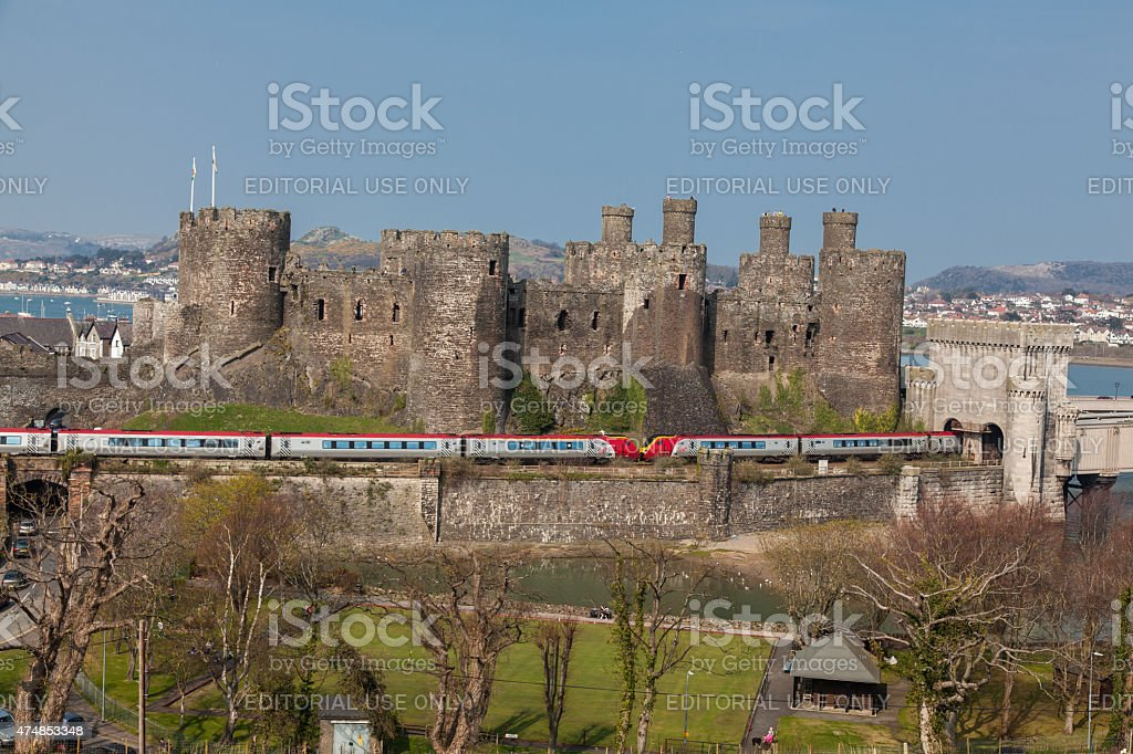 Conwy Castle and a Virgin Trains Voyager Passenger Train stock photo