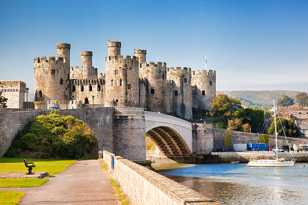 Conwy Castle in Wales, United Kingdom, series of Walesh castles Conwy, Wales , United Kingdom- September 10, 2014:  The Conwy castle with yacht wales stock pictures, royalty-free photos & images