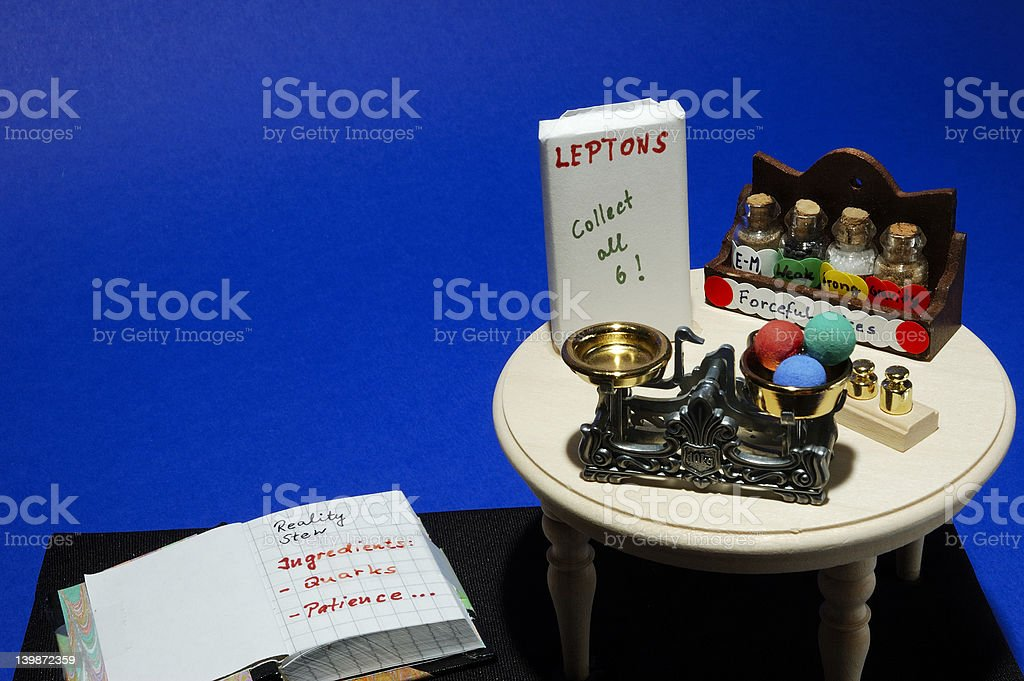 Cook book and Physics kitchen table stock photo