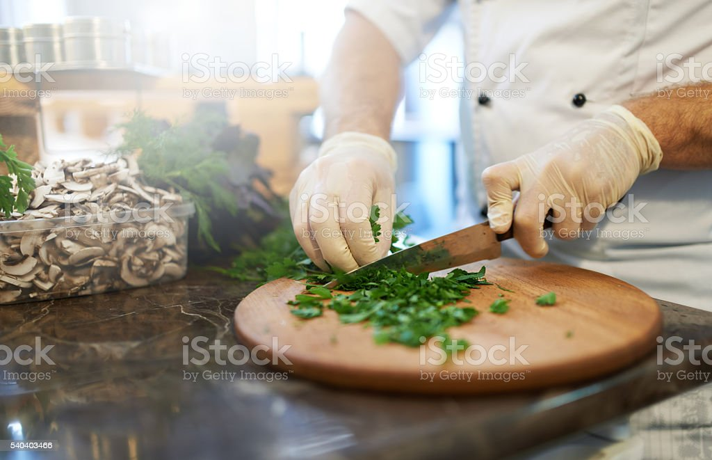 cook cuts the greens stock photo