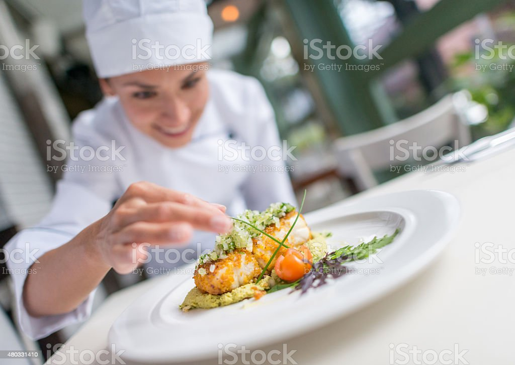 Cook decorating a beautiful plate stock photo