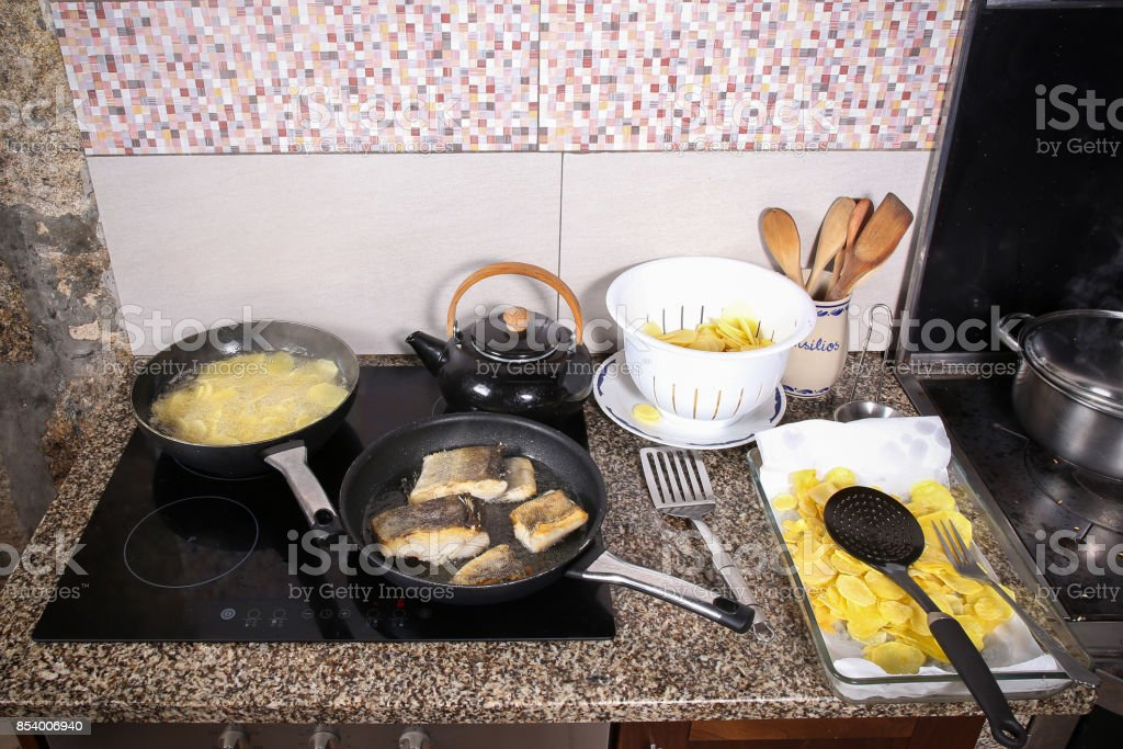 Cook fish in the pan stock photo