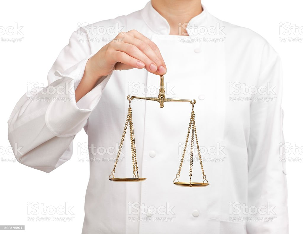cook holding a scale of justice stock photo