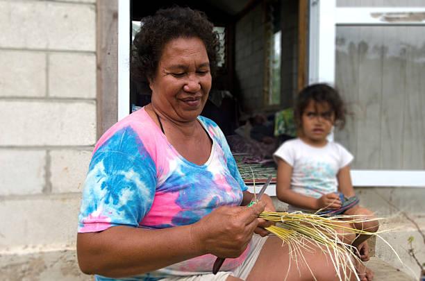 Cook Islanders family in Aitutaki Lagoon Cook Islands stock photo