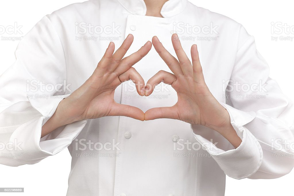 cook making a sign with both hands representing a heart stock photo