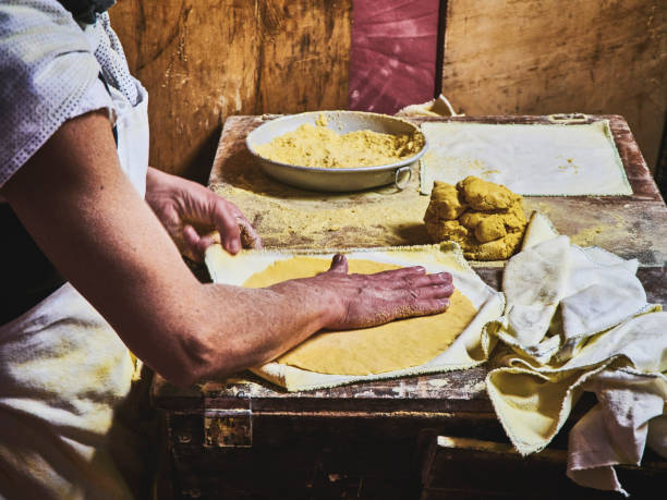 cook making tortillas on a wooden rustic table. - tortilla stock photos and pictures
