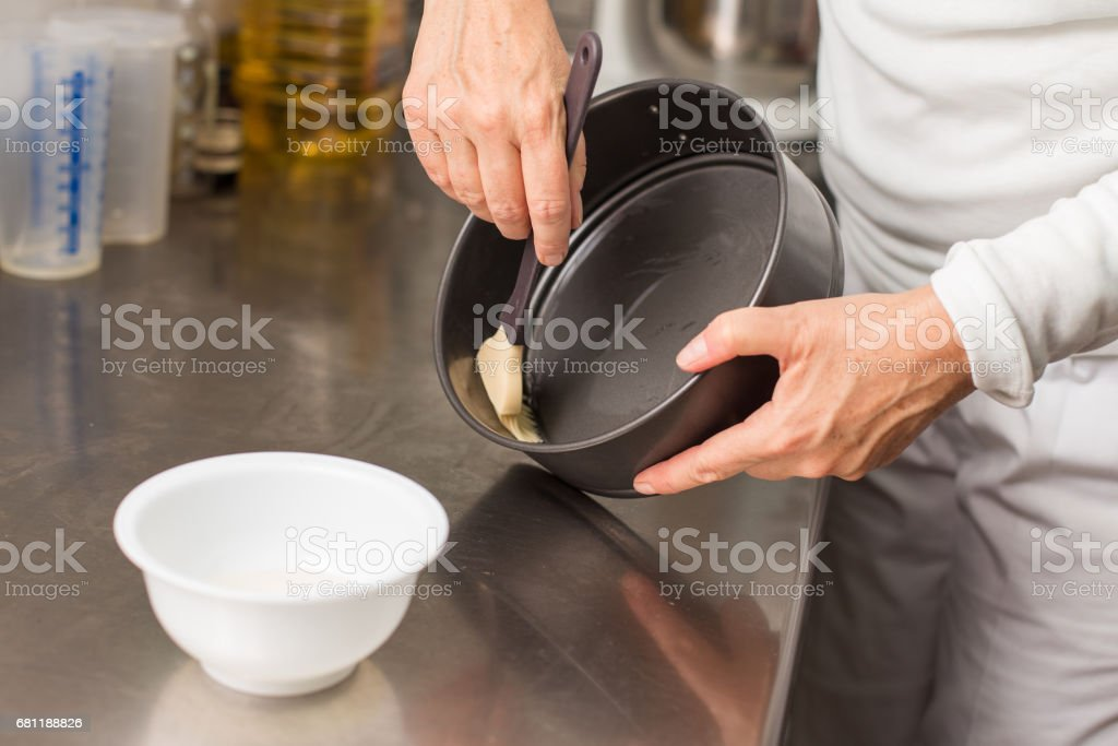 cook preparing mold for cooking stock photo
