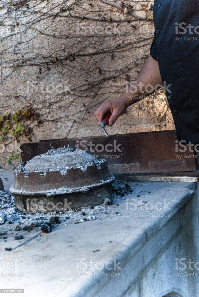 Cook Preparing Traditional Mediterranean Meal Peka stock photo