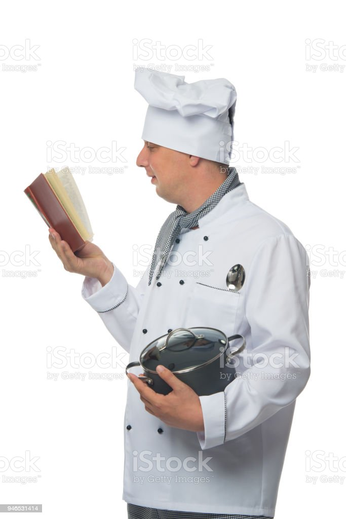 cook studying a book of recipes and holding a saucepan, on a white background stock photo