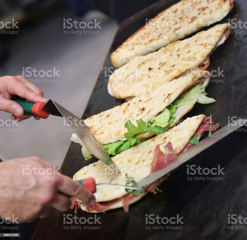 cook while cooking the piadina also called Spianata in Italian l stock photo