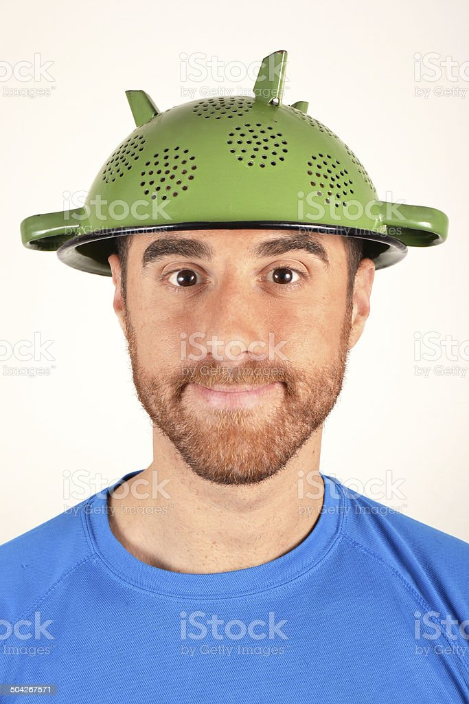 Cook with a colander on his head stock photo