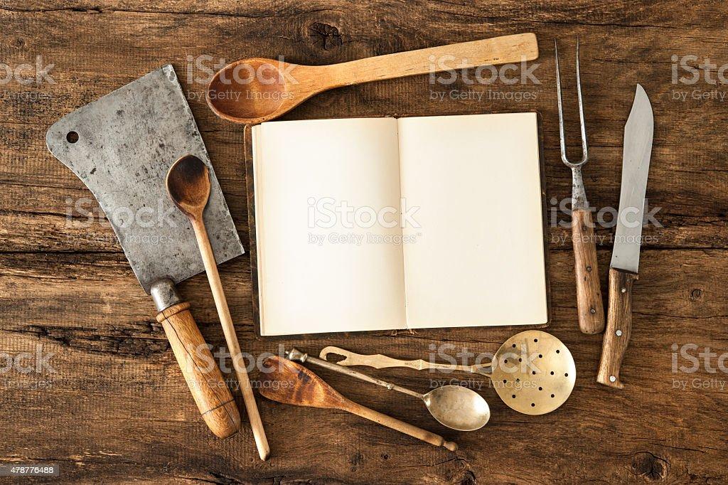 Cookbook and kitchen utensils stock photo
