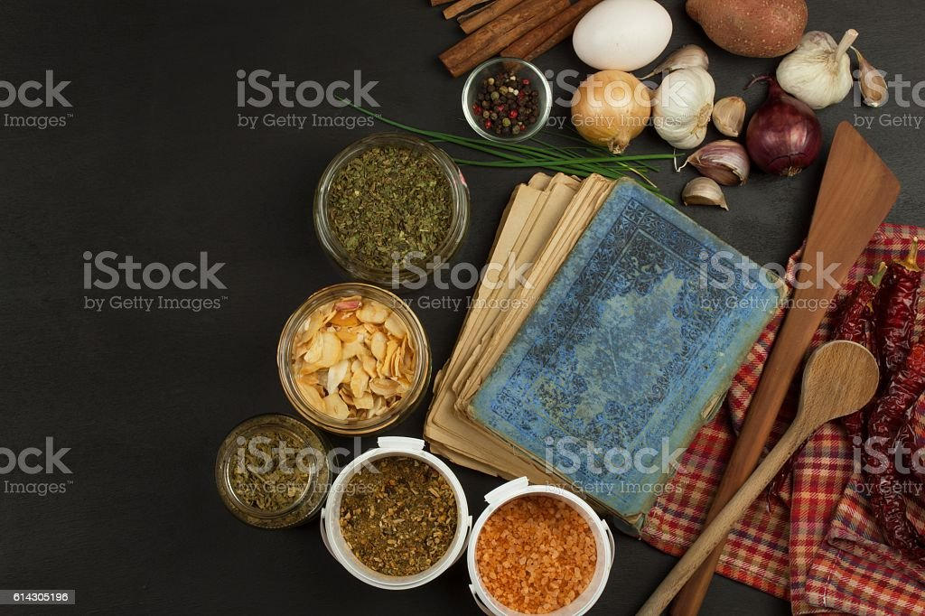 Cookbook and spices on wooden table. Cookbook and ingredients. stock photo