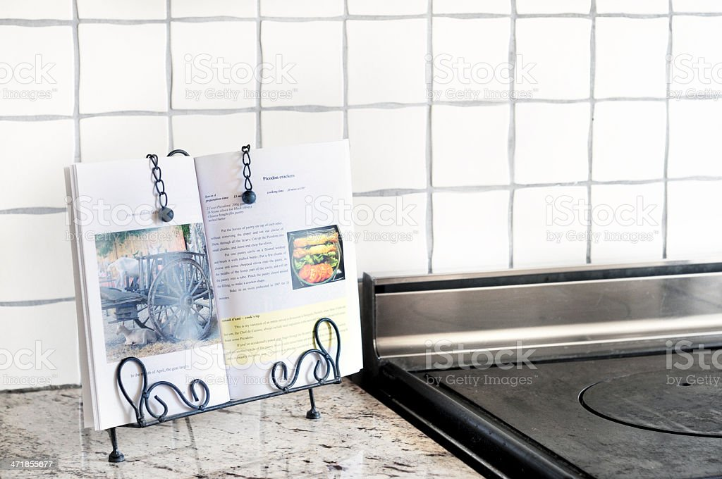 Cookbook on kitchen counter stock photo